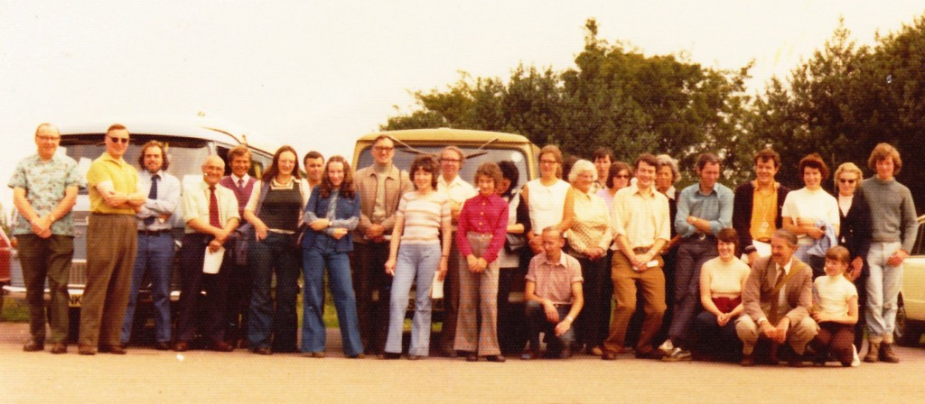 BCGS 1st Field trip. The back row (all those standing) left to right, 1 - 24, and kneeling, left to right, 1 - 4. 1. Doug Bedson. 2. Terry Bond. 3. Peter Parkes. 9. Bill Ward. 10. Eileen Bakewell. 16. Mrs Golledge. 17. Margaret Oliver. 18. Alan Cutler. 19. Freda Tabberner. 20. Peter Oliver. 21. Dave Wraight. 22. Sheila Pitts. Kneeling: 1. John Golledge. 2. Jenny Wraight